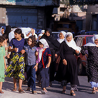 Women residents of Qana, Lebanon taking an evening stroll together in 1981.