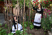 Konstantina (L) and Eythaleia (R) Tassiou inside a garden of a house in Vovousa village. The two sisters are quite young and not so used to the village lifestyle as the grew up in Ioannina city but their roots are in Vovousa and the bonds between the families from Vovousa are quite strong even if they live far from the village.