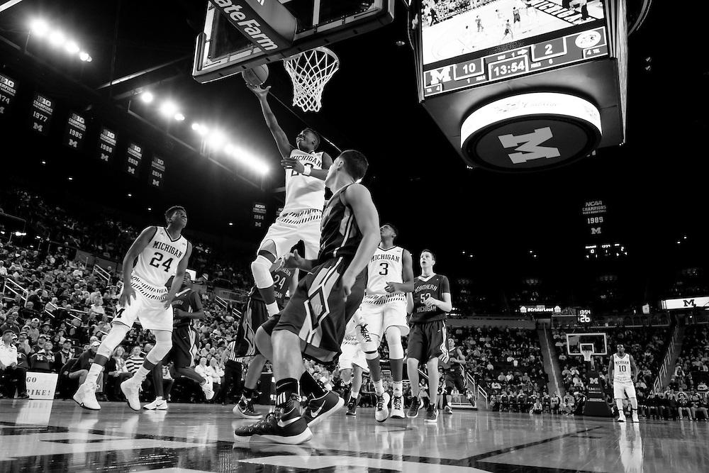 Nov 13, 2015; Ann Arbor, MI, USA; Michigan Wolverines guard Caris LeVert (23) goes to the basket against Northern Michigan Wildcats at Crisler Center. Mandatory Credit: Rick Osentoski-USA TODAY Sports