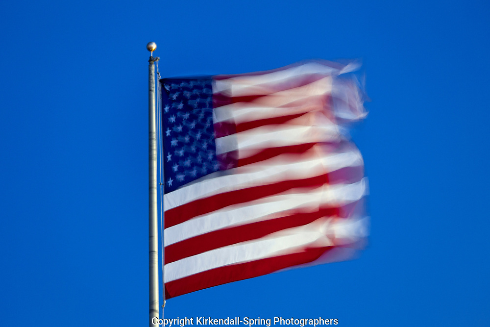NC00901...NORTH CAROLINA - United States Of America Flag blowing in a strong wind.