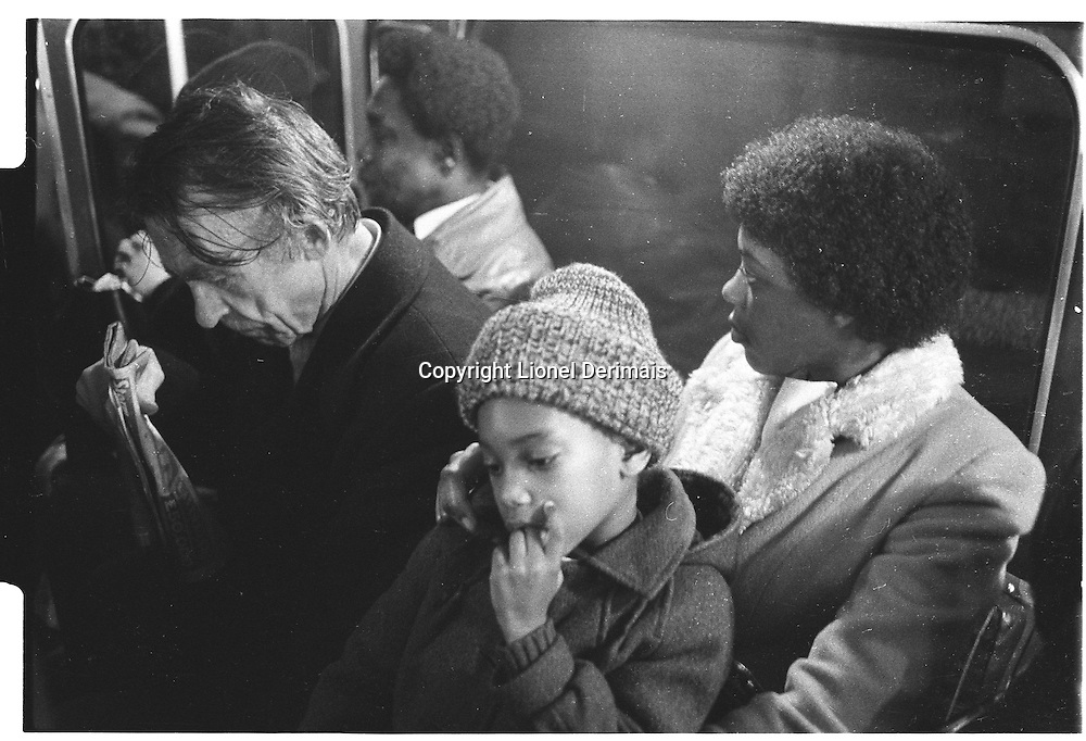 Child and mother on London bus, London street photography in 1982. Tri-X