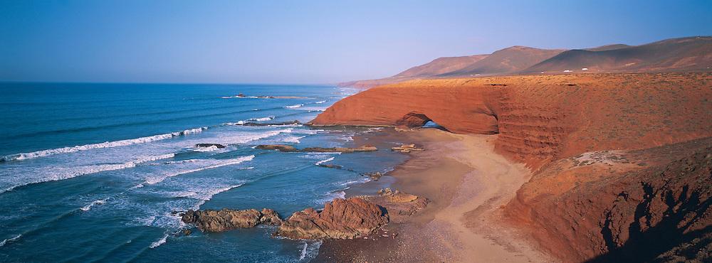 Morocco. Beach and red cliff of Legzira. Around Sidi Ifni ...