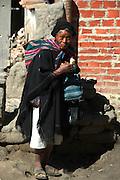 Old campesino man eating ice cream in the market in Tarabuco, Chuquisaca, Bolivia