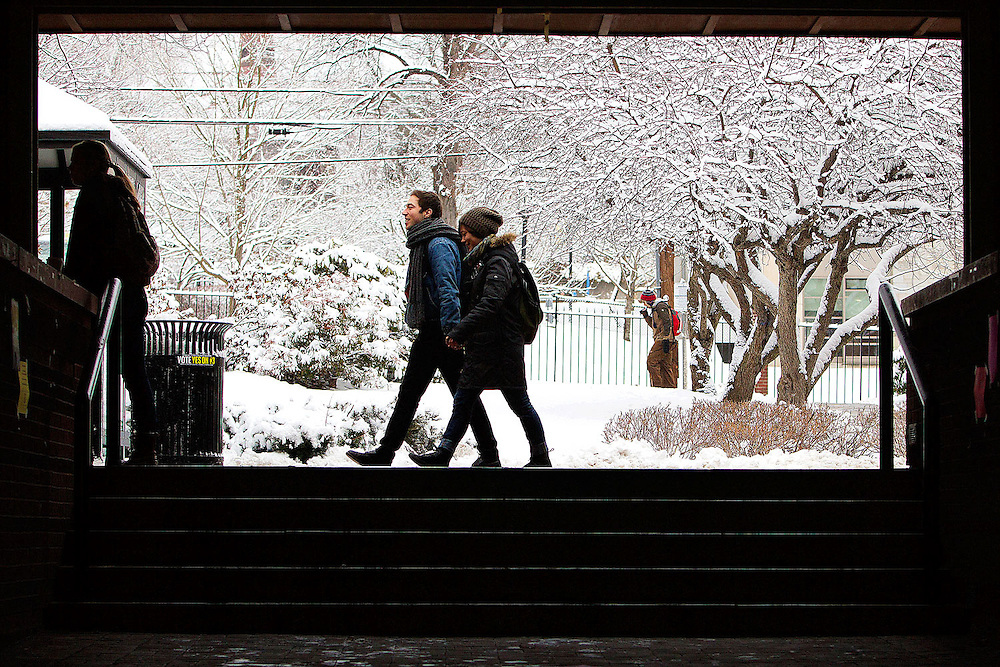 01/16/2013 -- SOMERVILLE, Mass. -- Students walk through the snow-covered campus of Tufts University on the first day of the spring semester on Jan. 16, 2013. (Kelvin Ma/Tufts University)