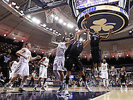 SOUTH BEND, IN - DECEMBER 21: Tahjere McCall #5 of the Niagara Purple Eagles and grabs for a rebound against the Notre Dame Fighting Irish at Purcel Pavilion on December 21, 2012 in South Bend, Indiana. (Photo by Michael Hickey/Getty Images) *** Local Caption *** Tahjere McCall