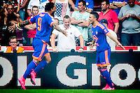 EINDHOVEN - PSV - Feyenoord , Voetbal , Seizoen 2015/2016 , Eredivisie , Philips Stadion , 30-08-2015 , Speler van Feyenoord Bilal Basaçikoglu (r) geeft de assist waaruit het eigen doelpunt viel voor de 0-1 hij viert dat met Speler van Feyenoord Colin Kazim-Richards (l) terwijl de supporter op de achtergrond zich enorm boos maakt