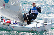 Sir Ben Ainslie celebrates winning a record breaking fifth medal during the London 2012 Olympics in his Finn sailing dinghy.