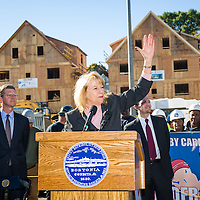 Executive Director of Dorchester Bay Economic Development Corporation Jeanne DuBois speaks on the site of the former Pearl Meats Packing Company which is now the center of the Quincy Heights Development in Boston, MA.