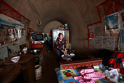 Chinese 'yaodong' or cave home dwellers Wang Qiuxia washes dishes in her cave home on the top of a mountain in Yichuan county of Yan'an city, Shaanxi Province China, 06 November 2012. The 'yadong' or cave dwellings are typical in the plateaus of northern China in Shaanxi Province where many of Yan'an's rural population still live in. They are mostly carved out from the yellow earth of the Loess hillsides and are about seven to eight metres deep with height and width of three metres. Former Communist leader Mao Zedong and his comrades are known to have hid in these cave homes during the civil war between the communists and nationalists in 1936 to 1948 as they battle the Kuomintang forces. China's new leaders slated to take over during the 18th National Congress beginning on 08 November are likely to face mounting pressures to tackle the country's rising income inequalities between urban and rural areas that are often the source of simmering resentment and growing unrests on the grassroot level.