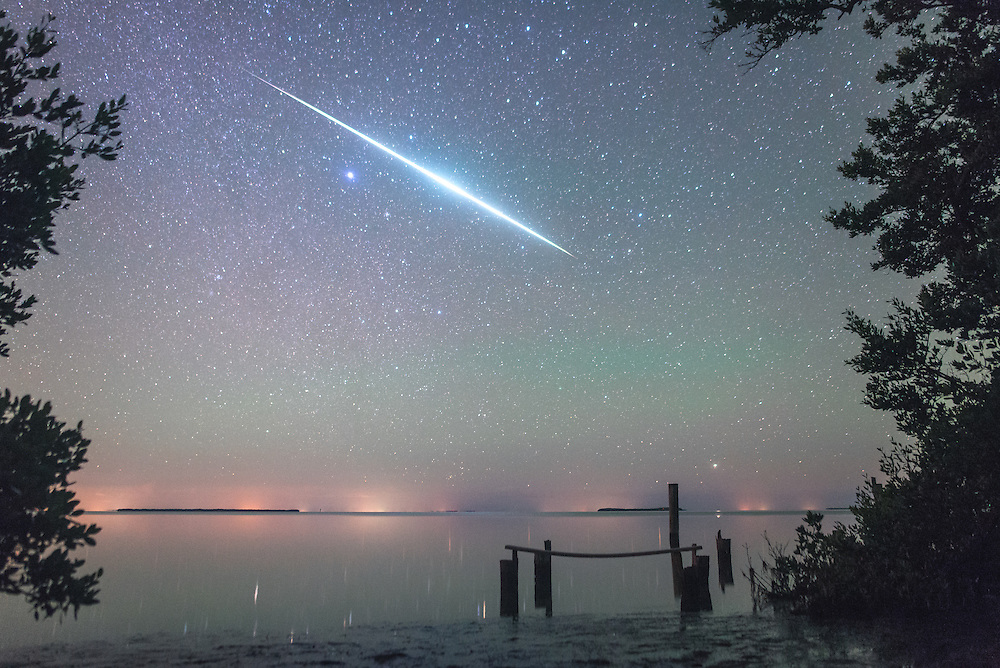 In December 2014 I went down to Flamingo campground in Everglades National Park to shoot the Geminids Meteor Shower. I was planing on camping for a few nights down there to shoot the shower and enjoy being away from civilization for a bit.<br /> <br /> On the second night I was there (also the peak of the shower) a few photographer friends come down and meet me to shoot for the night. <br /> <br /> The Geminids were incredible all weekend, with pitch black skies and meteors at least once a minute if not 5 a minute...it couldn't have gotten better.<br /> <br /> On my last day I hiked around looking for locations for the time lapse for that night, and came across this dock that was destroyed by hurricanes Wilma and Katrina. I went back that night and set up the D610 with the 24mm f/1.4 and went back to my campsite to lay back and watch the shower. <br /> <br /> Just before midnight I was looking off to the southeast and saw this giant meteor that lit up the sky for a minimum of 5 seconds...I hoped that the camera captured it but couldn't be sure til morning. <br /> <br /> After a beautiful night I woke up and went to grab the camera to look through the photos, and to my pleasant surprise I got it! Along with about 15 other meteors on that camera from the night. <br /> <br /> I've spend hundreds of hours under the stars and taking photos of them in 2014, the best way to increase your odds at grabbing a frame like this is to spend as much time doing it as possible.