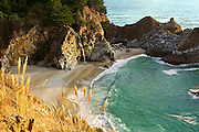 McWay Falls along the Big Sur coast in Julia Pfeiffer Burns State Park, California. One of a few that falls into the ocean, it's an incredibly scenic waterfall along the beach in a cove.