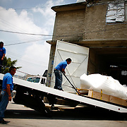 The Our Lady of Guadalupe statue is loaded onto a truck for the journey north at a foundry in Mexico City. The statue was commissioned by the historic Our Lady of Guadalupe church in Santa Fe, New Mexico. The statue was commissioned and funds raised after a controversial state-sponsored art exhibit that pushed the boundaries of the sacred and traditional image of Our Lady of Guadalupe. The statue was loaded onto a flatbed truck and driven north, following El Camino Real, the ancient route the Spanish settlers took north to settle New Mexico and the RIo Grande valley.