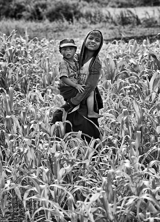 Children in a corn field on the road to Lake Inle, Myanmar.