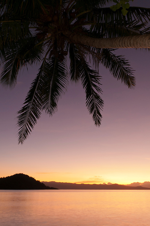 Sunset glow over ocean at Matangi Private Island Resort, Fiji.