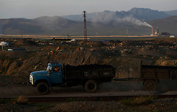 A picture made available on 05 July 2012 of a coal truck driving over a coal mining site in the mining town of Nalaikh in Mongolia, 02 July 2012. Once a thriving mining town, Nalaikh is one of first and oldest mining site in Mongolia but has seen a decline in its fortune as mining disasters and accidents plague the site. With little government oversight, only a handful of small companies and informal miners work on the site with scant regard to safety standards. Mongolia is rich in a variety of natural resources including forests, coal, iron ore, gold and copper. Expansion of the mining industry has turned the sector into the most important income source and led to an economic growth rate last year of around 17 per cent. The majority of raw materials are exported to China. Seeking to to reduce the dependency on China for exports and Russian imports, Mongolia has embarked on a policy of closer economic ties with other countries such as Germany, Canada and the United States. Despite impressive growth rates, about one-third of the population lives below the poverty line while unemployment and inflation are high.