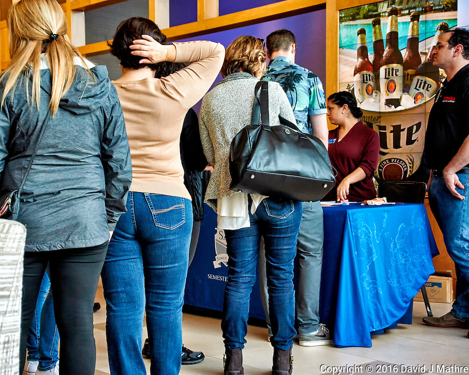 Students signing up for the beer card at the Hilton hotel in San Diego. Needed to purchase beer or wine during the Semester at Sea, 2016 Spring Semester Voyage. Image taken with a Nikon 1 V3 camera and 10-30 mm VR lens (ISO 800, 18 mm, f/4.5, 1/100 sec).