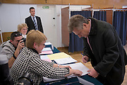 Aleksander Kwasniewski former President of Poland voting with his wife Jolanta and daughter Ola photo Piotr Gesicki