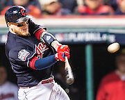 CLEVELAND, OH - OCTOBER 25, 2016: Roberto Perez #55 of the Cleveland Indians hits a three-run home run in the bottom of the eighth inning bringing home teammates Brandon Guyer #6 and Lonnie Chisenhall #8 during Game 1 of the 2016 World Series against the Chicago Cubs at Progressive Field on October 25, 2016 in Cleveland, Ohio. (Photo by Jean Fruth)