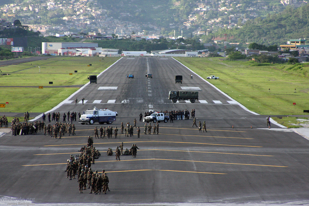 """Tegucigalpa, Honduras. July 5th, 2009. A plane carrying deposed President Manuel """"Mel"""" Zelaya, scheduled to return from Nicaragua after being forcibly removed from power by a Coup d'Etat on June 28th, 2009, could not land as members of the Honduran Armed Forces blocked the landing strip."""