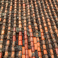 Spanish style red and orange roof tyles in Cuenca, Ecuador.