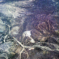 Baja California Sur from the air. The magnificent desert in Baja California peninsula is best seen and understood from the air. The Sea of Cortez on one side, Pacific Ocean on the other, beautiful beaches, wanted surf spots, beautiful beach resorts and in between - the desert.