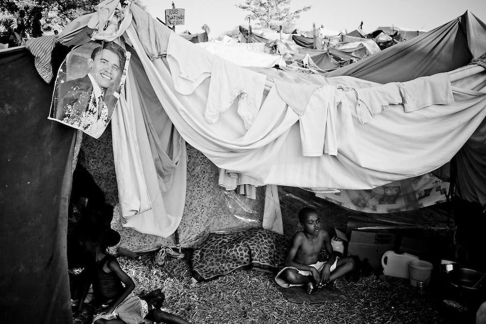 A poster of Barack Obama hangs above a tent in a camp for those displaced by the recent earthquake in Petionville, outside Port-au-Prince, Haiti.
