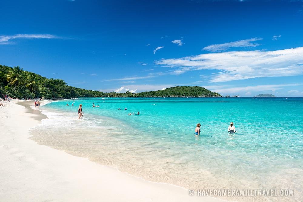 Swimmers enjoy the warm tropical waters of Hawksnest Bay on St John in the US Virgin Islands.