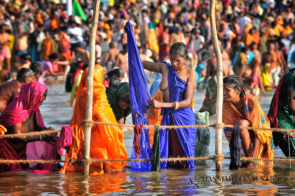 Pilgrims at the banks of Sangam, the confluence of the holy rivers Ganga, Yamuna and the mythical Saraswati..Hindu devotees bathe in the waters of the holy Ganges river believing that it washes away their sins and ends the process of reincarnation.