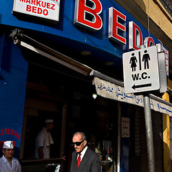 Beirut residents pass a popular sandwich shop in the Armenian neighborhood of Bourj Hammoud in Beirut, Lebanon on March 20, 2006. Lebanon boasts 18 different religious and cultural confessions.