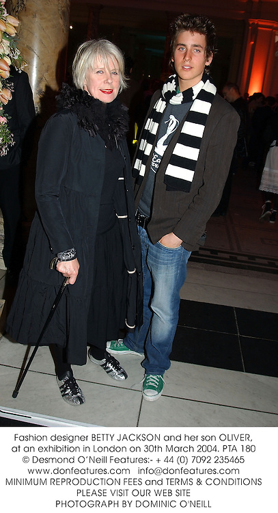 Fashion designer BETTY JACKSON and her son OLIVER, at an exhibition in London on 30th March 2004.PTA 180