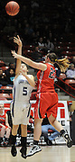 gbs030912z/SPORTS/Greg Sorber --  Corona's Kenzee Criswell, 5, shoots against Elida's Jhannah Gage, 23, during the B Girls State Championship in the Pit on Friday, March 9, 2012. Elida beat Corona 59-41.