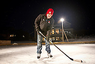 MADISON, WI — FEBRUARY 16, 2015: UW-Madison Women's Hockey Coach Mark Johnson on his personal ice rink outside his Verona home, Monday, February 16, 2015.