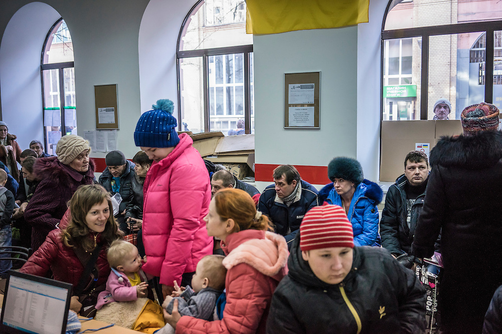 People crowd into a center where they are able to register for benefits available to those displaced by the fighting between Ukrainian forces and Pro-Russian rebels on Wednesday, February 11, 2015 in Kharkiv, Ukraine.