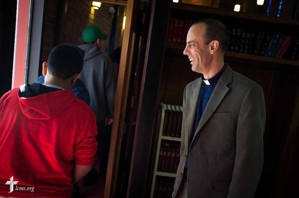 The Rev. Brandon Martin, associate pastor of Salem Lutheran Church,  greets members and visitors before a monthly bilingual worship on Sunday, Nov. 22, 2015, at the church in Springdale, Ark. LCMS Communications/Erik M. Lunsford