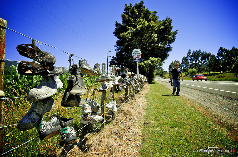 Road to Harwoods Holes forest where we found a very interesting fence decorated with h<br /> old traveller's shoes.  New Zealand.