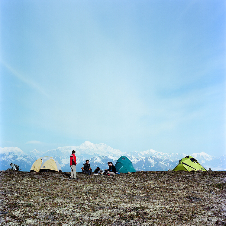 Campers on Kasugi Ridge in Denali Nationsal Park, Alaska with Mt Denali in the background. 2009