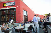 Patrons fill the patio of the tap room at Wormtown Brewery in Worcester, Massachusetts on August 28, 2015.  Matthew Healey for The Boston Globe<br /> <br /> (MAGAZINE Story Editor Francis Storrs, Assigning editor Jim Wilson, Visuals editor Lloyd Young)