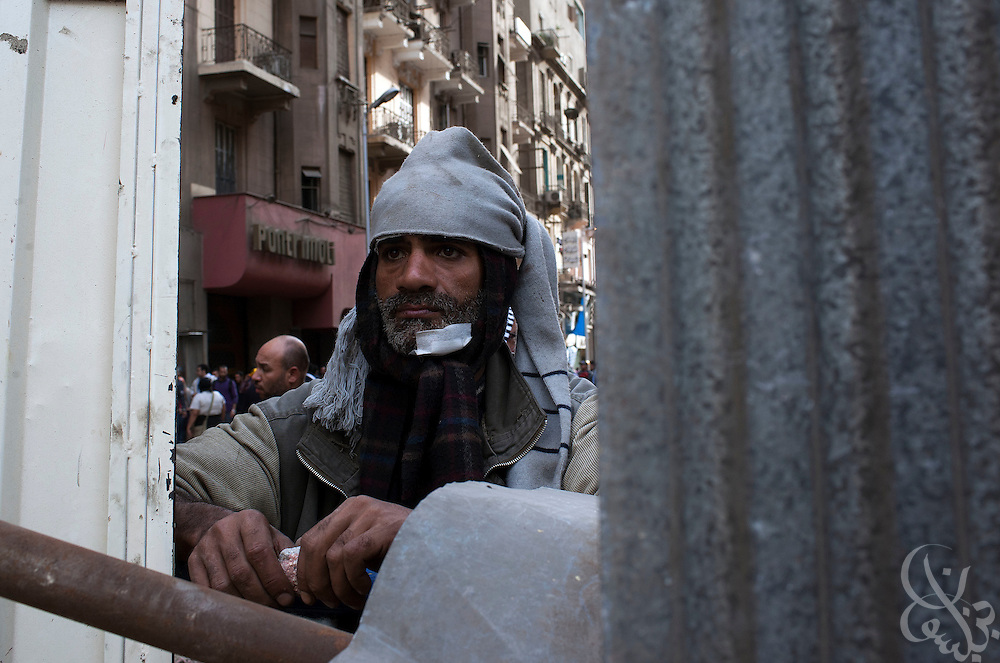 "An Egyptian anti-Mubarak protester watches for approaching Mubarak supporters from defensive positions during the ""Day of Departure"" demonstration February 04, 2011 near Tahrir Square in Cairo, Egypt. The Egyptian military and demonstration organizers enforced a several hundred meter buffer zone between anti and pro Mubarak factions of protesters and were able to prevent large scale clashes between the two sides that had taken place the past several days. ."