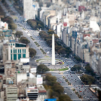 USE ARROWS &larr; &rarr; on your keyboard to navigate this slide-show<br /> <br /> Buenos Aires, Argentina 22 August 2009<br /> Aerial view of 9 de Julio Avenue and the Obelisco monument, in Buenos Aires.<br /> Avenida 9 de Julio is the largest avenue in Buenos Aires, Argentina. Its name honors Argentina's Independence Day. (July 9, 1816).The avenue runs roughly one kilometer to the west of the Rio de la Plata waterfront, from the Retiro district in the north to Constitucion station in the south. The avenue has seven lanes in each direction.<br /> Photo: Ezequiel Scagnetti
