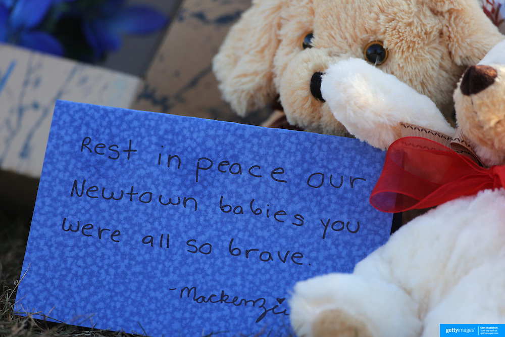 A message amongst the flowers at he shrine under the school sign in Sandy Hook after yesterday's shootings at Sandy Hook Elementary School, Newtown, Connecticut, USA. 15th December 2012. Photo Tim Clayton