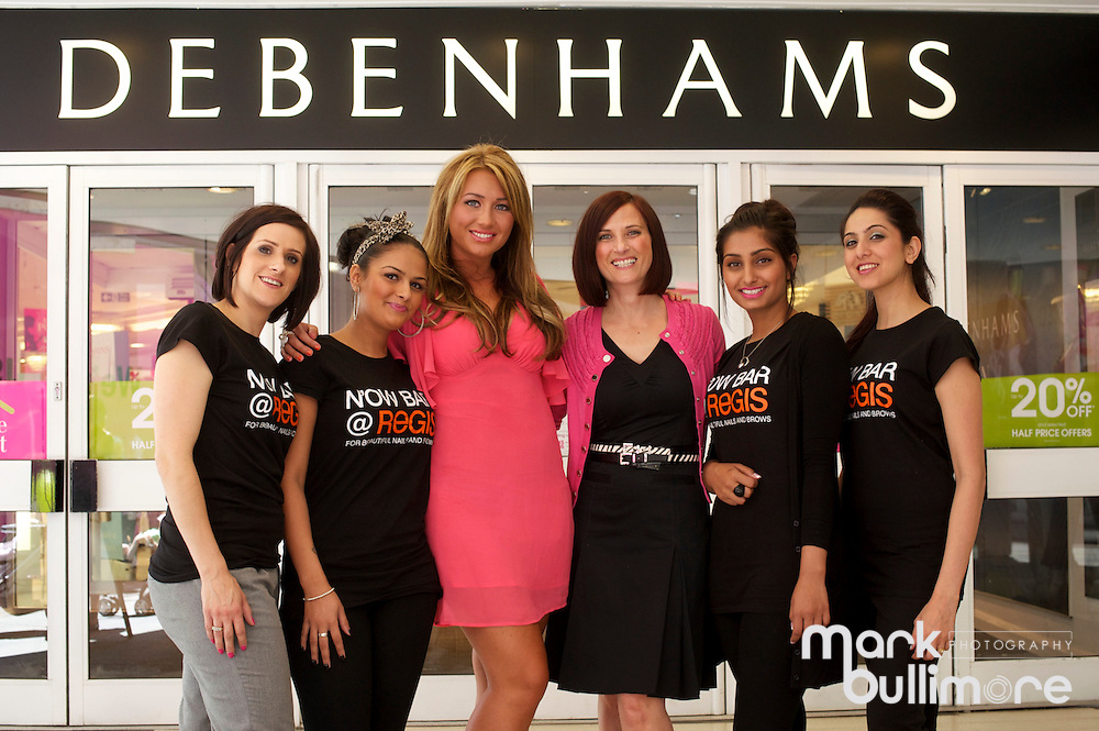 Romford, Essex. Lauren Goodger (star of The Only Way Is Essex) at the offical opening of the Regis Hair and Beauty nail bar at Debenhams in Romford, pictured with Regis Staff from left Sarah Smith, Cherelle Marie, Lauren Goodger, Sam Lewis, Ritu Kaur and Navinder Sokhi..Picture by Mark Bullimore/EAPS - 3rd June 2011