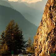 Cars along the Sea to Sky Highway, with new retaining wall road widening.  Near Whistler BC, Canada.