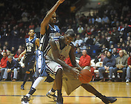 "Ole Miss forward Terrance Henry (1) makes a move against Penn State forward David Jackson (15) at the C.M. ""Tad"" Smith Coliseum on Friday, November 26, 2010. Ole Miss won 84-71."