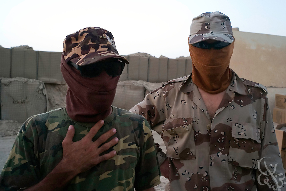 "Ali Hussein Khalaf, and Mohsen Jabar Khalaf, alleged members of a local Sunni neighborhood militia called the ""local committee"" meet with a U.S. Army officer at a base in the Burhitz neighborhood of Baquba, Iraq June 28, 2007. In April of 2007 the U.S. Army began cooperating with the nearly 200 members of the Sunni militia to combat Al Qaeda in the area, and since then has enjoyed a good deal of success (and no attacks on U.S. forces in Burhitz) in securing that neighborhood. Although some of the groups members are former members of known local insurgent groups like the ""1920's Brigade"", both the militia and the U.S. Army say that they have found a common enemy in Al Qaeda and have pledged to work together.  ...."