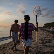 CAPE CHARLES, VA - JUNE 20: Frank Amato, left, and his wife Larana Amato, both of Carrollton, Va., hunt for crabs along Sunset Beach on Friday, June 20th, 2014 near Cape Charles, Va. (Photo by Jay Westcott/For The Washington Post)