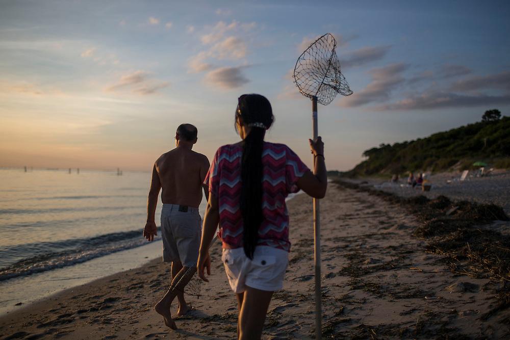 CAPE CHARLES, VA - JUNE 20: Frank Amato, left, and his wife Larana Amato, both of Carrollton, Va., hunt for crabs along Sunset Beach on Friday, June 20th, 2014 near Cape Charles, Va. (Photo by Jay Westcott/For The Washington Post)