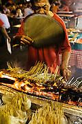 Traditional satay vendor at Lau Pa Sat Festival Pavillion food center