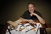 Wood artist Doug Lamont with the tools of his trade, at his drafting table.