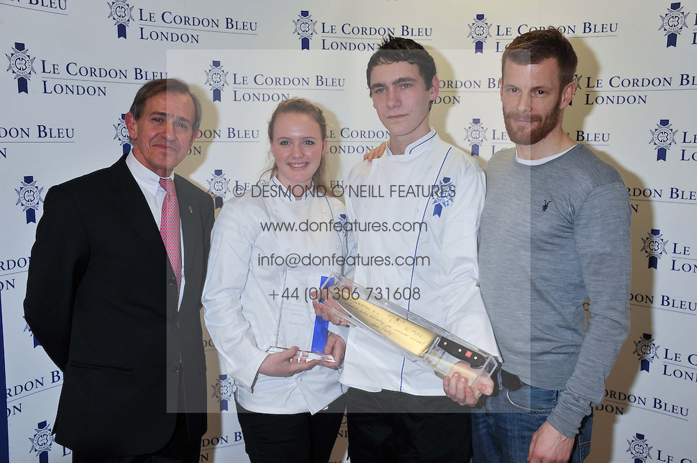 Left to right, ANDRE COINTREAU President of Cordon Bleu International , ABIGAIL WATSON winner of the Cordon Bleu scholarship, LLOYD PINDER winner of the Cordon Bleu scholarship and chef TOM AIKENS at the Grand Opening of Le Cordon Bleu's International Flagship School at 15 Bloomsbury Square, London WC1 on 7th February 2012.