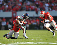 Ole Miss' Randall Mackey (1) is tackled by Georgia linebacker Christian Robinson (45) and Georgia linebacker Alec Ogletree (9) at Sanford Stadium in Athens, Ga. on Saturday, November 3, 2012.